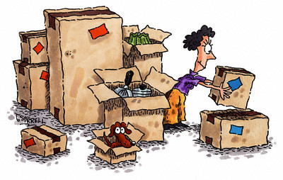 Woman with Moving Boxes --- Image by © Royalty-Free/Corbis